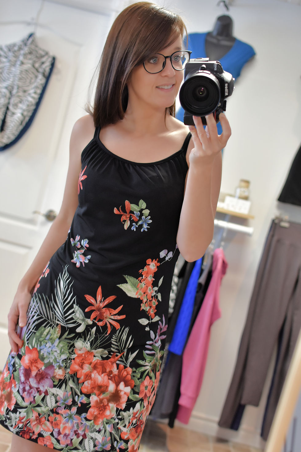 Black or navy floral dress with spaghetti straps made by Collection Space, a women's clothing brand